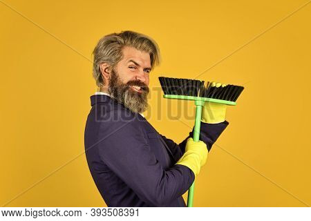 Clean Service People. Mature Male Worker With Broom Cleaning. Male Janitor Cleaning With Broom. Busi