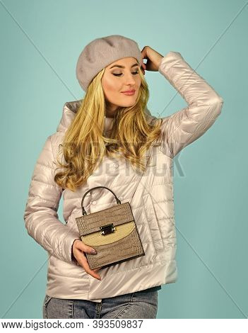 Beautiful Woman Holding Bag. Autumn Trendy Outfit Woman In Stylish Beret. Leather Handbag. Beauty An