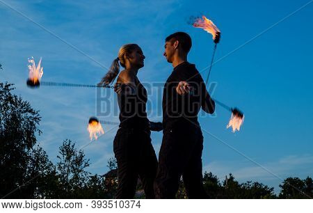 Fire And Flame. Sexy Couple Perform Poi Dance Blue Sky. Flamimg Poi Swinging. Fire Performance. Art