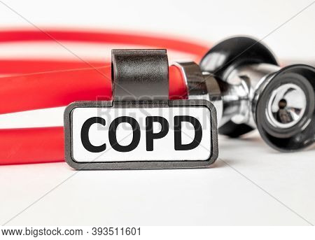 Copd Chronic Obstructive Pulmonary Disease Lettering On A Business Card With A Holder, Next To The R