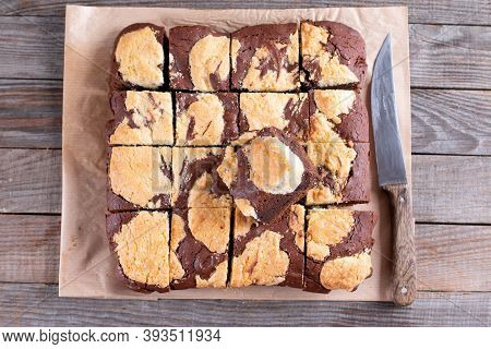 Chocolate Spongy Brownie Cakes With Cookies - Brookies On A Wooden Table. Trend Dessert