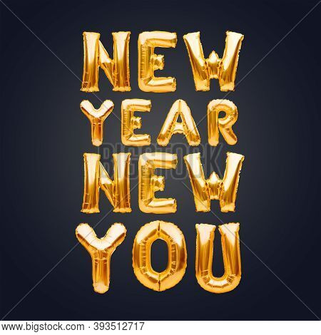 New Year New You Phrase Made Of Golden Inflatable Balloons On Dark Background. Helium Balloons, Foil