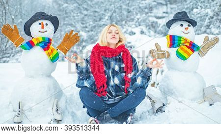 Winter Day. Enjoying Nature Wintertime. Winter Portrait Of Young Beautiful Woman In Snow Garden. Fun