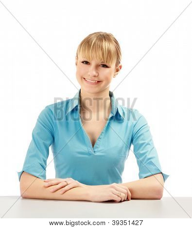 Closeup portrait of an attractive young woman sitting at the desk , isolated on white background