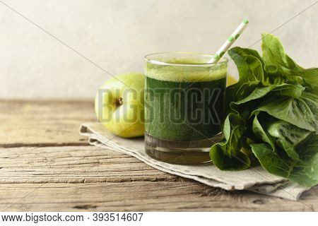 Healthy Green Smoothie On Vintage Wooden Table. Fresh Detox Nutrient.