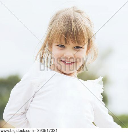 Child Portrait Of Cute Blond Hair Little Girl In White.