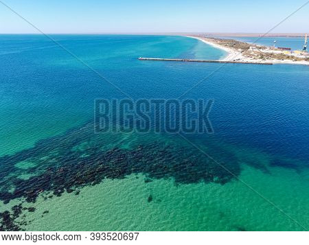 Aerial Drone View Of A Tropical Sandy Beach Dividing An Exotic Turquoise Sea And Lake. Sand Bar In T