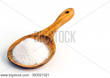 Wooden Spoon With Baking Soda On Isolated White Background, Chemical Compound In Crystalline Powders