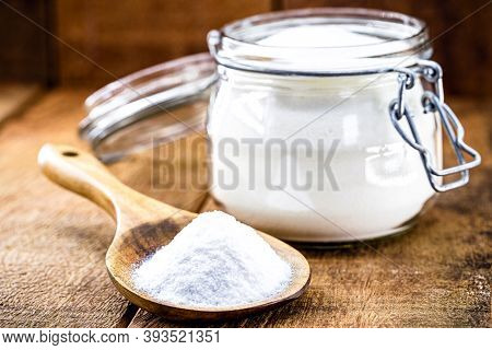 Pot Of Baking Soda With Wooden Spoon, Chemical Compound Used In Industry And Cooking, As Antacid Or