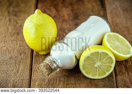 Glass With Baking Soda And Citrus Fruits Like Lemon Or Orange Around. Home Remedy Against Stomach Ac