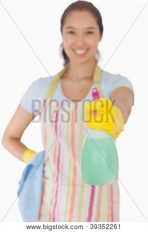 Young woman using a window cleaner