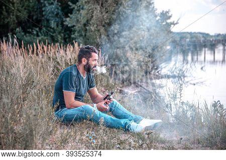 Stylish Vape Man Blows Up A Couple An Vape In The Outdoors. Vape.