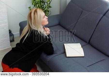 Girl Praying. Side View Of Beautiful Young Blond Hair Woman Praying At Home