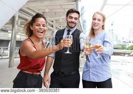 Successful Multiethnic Business People Are Clinking Glasses Of Champagne With Smiling While Celebrat