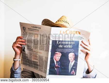 Paris, France - Nov 5, 2020: Cowboy Woman Reading In Living Room The Latest Newspaper Featuring On C