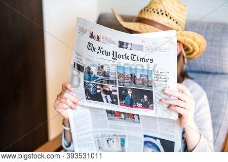 Paris, France - Nov 5, 2020: Woman Reading In Living Room The Latest Newspaper The New York Times Fe