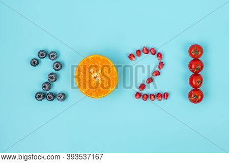 2021 Happy New Year And New You With Fruits And Vegetables; Blueberries, Orange, Pomegranate Seeds A