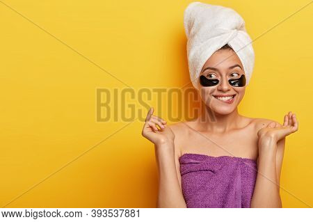 Isolated Shot Of Pleased Caucasian Woman Gets Pleasure From Beauty Treatments, Has Problematic Skin