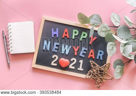 Wooden Colorful Alphabet On Wood Letter Board In Words Happy New Year 2021 On Pastel Pink Background