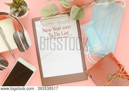 Word New Year 2021 To Do List On Clipboard With Stationery, Mask And Hand Sanitizer On Pastel Pink B