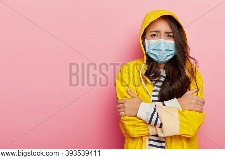 Upset Asian Woman Trembles From Cold, Has Virus Transmitted Through Airbone Droplets, Wears Protecti