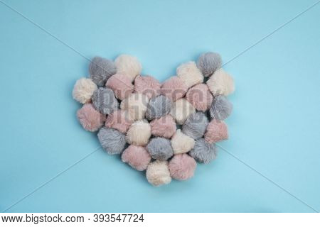 Valentine's Day Holiday. Heart Made Of Soft Fluffy Pom-poms On A Blue Background. Valentine's Day Ca