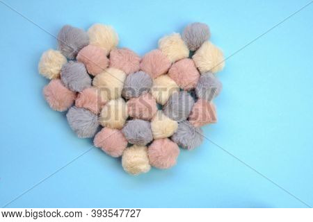 Valentine's Day. Heart Made Of Soft Fluffy Pom-poms On A Blue Background. Valentine's Day Card In Pa