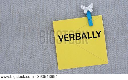 Verbally - Words On Yellow Paper With Clothespin On Gray Background. Info Concept