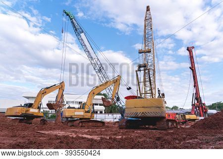 Excavator Heavy Machine And Mobile Crane Tower Crane In New Construction Site