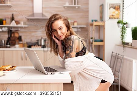 Care Free Woman During Breakfast Wearing Sexy Underwear Using Laptop. Attractive Blonde Lady With Ta