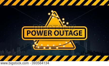 Power Outage, Yellow Warning Logo Wrapped With A Garland On The Background Of The City Without Elect