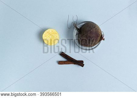 Ingredients For Making Beetroot Wades On A Blue Background. Beetroot, Lemon, Cinnamon. Healthy Nutri