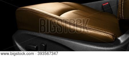 Brown Leather Interior Of The Luxury Modern Car. Perforated Orange Leather Comfortable Seats With St