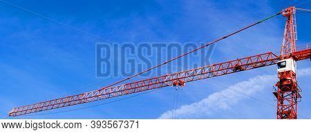 Construction Crane Tower Background. Crane And Building Working Progress. Red Lifting Faucet. Constr