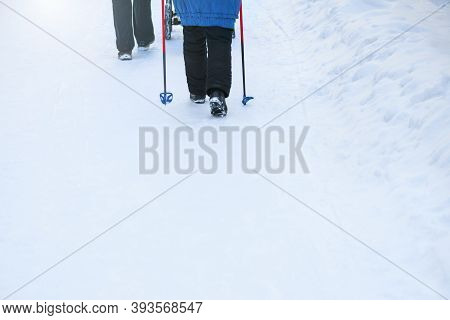 Nordic Walking. A Woman Walks With Nordic Walking Sticks In A Winter Forest. There Is Space For Text