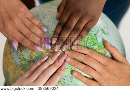 A Close-up Shot, Like On A School Globe, The Girls Are Holding Each One Hand As A Sign Of Cooperatio