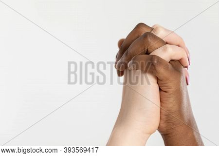 Clasped In A Loving Embrace, The Hands Of Two Loving Women Raised Up Symbolize Joy, Freedom And Raci