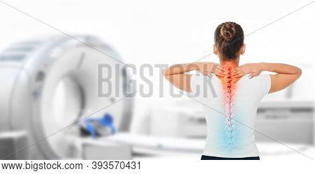 Medicine Poster For Ct Scan Human Spine. Woman With Pain In Cervical Spine Standing Near A Tomograph