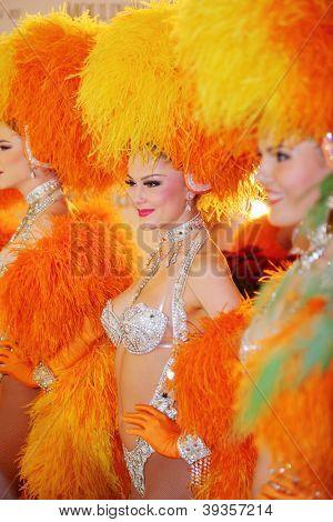 MOSCOW - DECEMBER 15: Beautiful women in orange fake fur of famous Parisian cabaret Moulin Rouge in Moscow at Crocus City Mall on December 15, 2011 in Moscow, Russia.