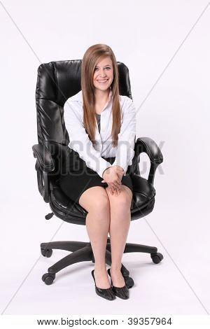Secretary Sitting In Swivel Chair