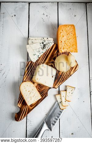 Various Types Of Cheese. On A White Wooden Background. Dor Blue, Parmesan, Cachocavallo. Homemade Ch