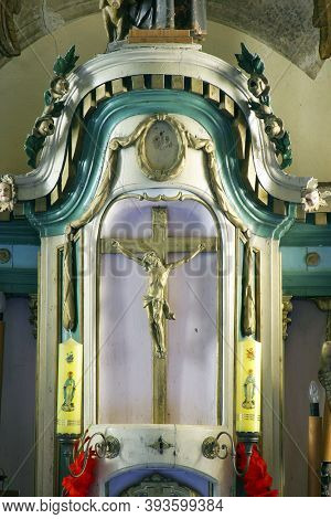 SLAVETIC, CROATIA - JULY 22, 2013: Crucifixion on the high altar in the parish church of St. Anthony the Hermit in Slavetic, Croatia
