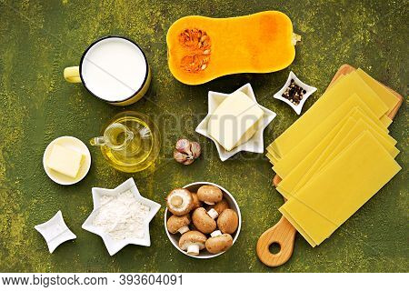 Prepared Ingredients For Cooking Lasagna With Pumpkin And Mushrooms On An Olive Concrete Background.