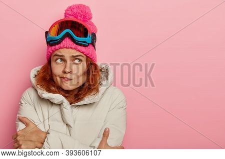 People, Hobby And Winter Holidays Concept. Unhappy Young European Woman Trembles From Cold, Purses L