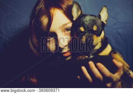 Young Girl With Pet Dog. A 9 Or 10 Year Old School Girl With A Chihuahua.