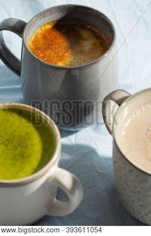 Vegan Cocoa Drink With Matcha, Turmeric And Cinnamon On Blue Background Close-up. Dairy Free Beverag