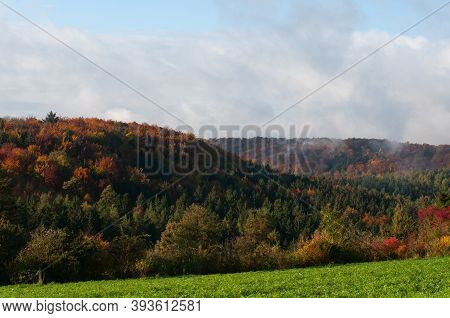 Wooded Hills In Swabian Alb On A Sunny Morning In Autumn With Rising Fog
