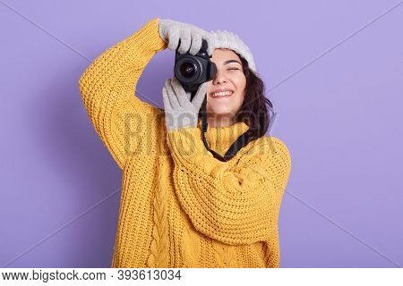 Woman Takes Photos, Smiling Female Holding Photographic Camera, Keeps One Eye Closed, Wearing Warm C