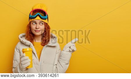 Winter Holidays And Active Lifestyle Concept. Lovely Redhead Woman Dressed In Comfortable Warm Outer