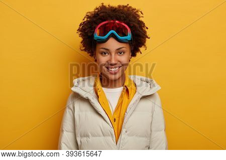 Sports Holidays, Travel Lifestyle And Winter Adventure Concept. Glad African Woman With Toothy Smile